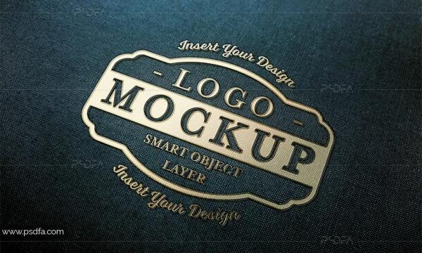 موکاپ لوگوی طلایی بر روی پارچه مشکی به صورت لایهباز برای فتوشاپ