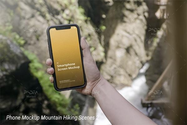 موکاپ موبایل آیفون در دست کوهنورد به صورت لایه باز برای فتوشاپ
