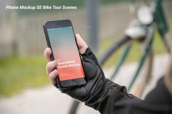 موکاپ موبایل آیفون SE در دست کنار دوچرخه و پارک iPhone SE Mockup